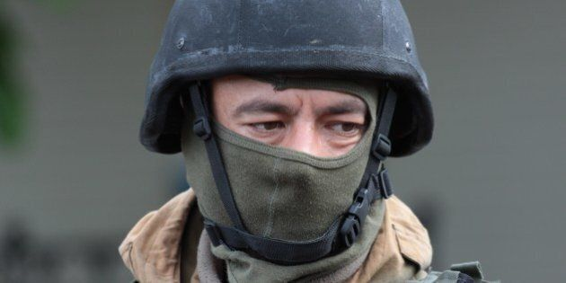 A Ukrainian soldier looks as he guards a checkpoint near the eastern Ukrainian city of Slavyansk on May...