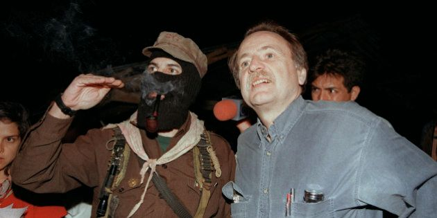 Regis Debray (R), the French writer and philosopher who fought alongside Ernesto 'Che' Guevara, confers...