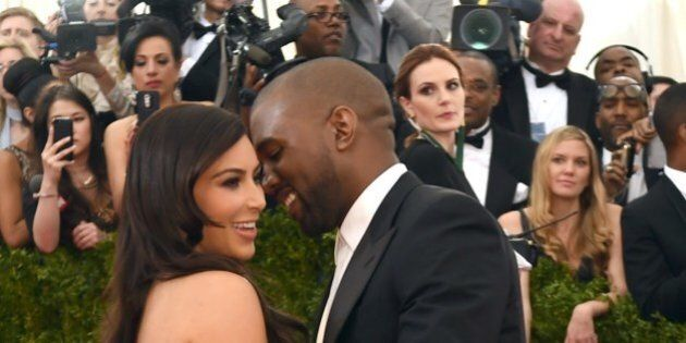 Kanye West (R) and Kim Kardashian arrive at the Costume Institute Benefit at The Metropolitan Museum of Art May 5, 2014 in New York. AFP PHOTO/Timothy A. CLARY        (Photo credit should read TIMOTHY A. CLARY/AFP/Getty Images)