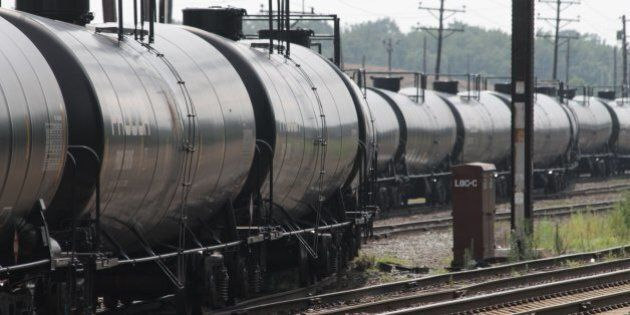 Empty railroad tank cars snake their way into a storage yard in Newark, Delaware, July 28, 2013 The cars...