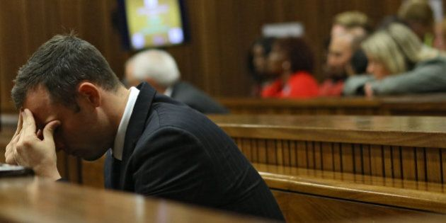 South African Paralympic athlete Oscar Pistorius is pictured during a hearing of his murder trial at...