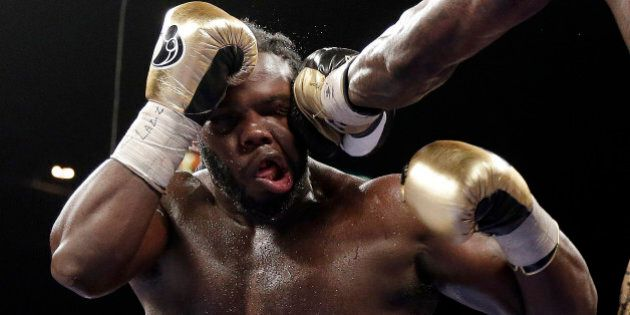 Bermane Stiverne takes a punch from Deontay Wilder during their WBC heavyweight championship boxing match...