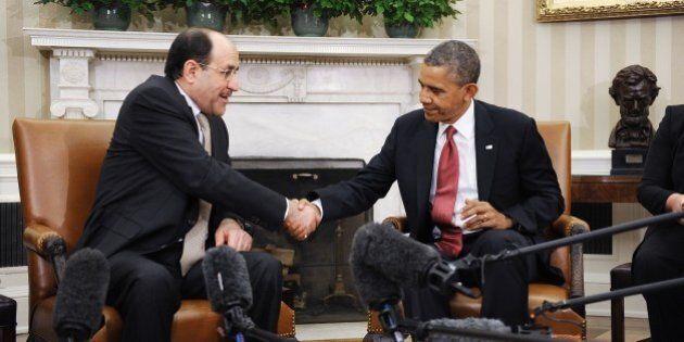 WASHINGTON, DC - NOVEMBER 01: Iraqi Prime Minister Nouri Al-Maliki (L) shakes hands with U.S. President...