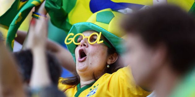 SAO PAULO, BRAZIL - JUNE 12: A Brazil fan cheers before the Opening Ceremony of the 2014 FIFA World Cup...