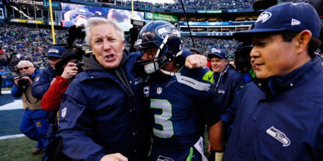 SEATTLE, WA - JANUARY 18: Head coach Pete Carroll celebrates with Russell Wilson #3 of the Seattle Seahawks after the 2015 NFC Championship game against the Green Bay Packers at CenturyLink Field on January 18, 2015 in Seattle, Washington.  (Photo by Kevin C. Cox/Getty Images)