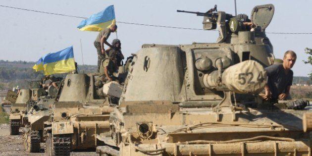 A column of Ukrainian tanks travels in Donetsk region on September 3, 2014. Beleaguered Ukrainian President...