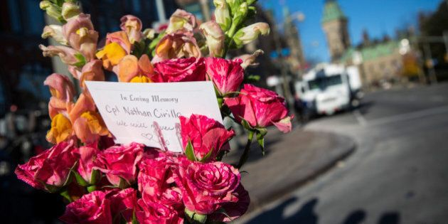OTTAWA, ON - OCTOBER 23: Flowers are left in memorial for Cpl. Nathan Cirillo of the Canadian Army Reserves,...