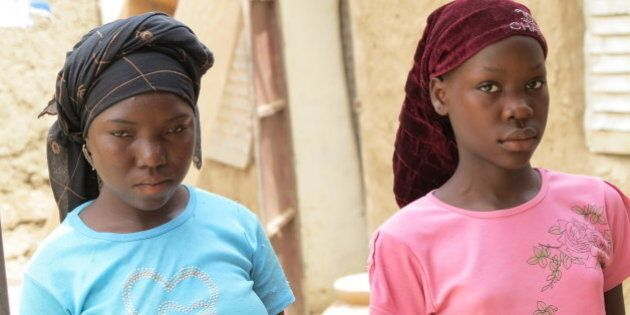 KWASSAW, NIGERIA - JUNE 16: Ouma Sayadou, 15, with her best friend in the village of Kwassaw, Nigeria...