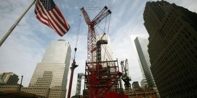 NEW YORK - AUGUST 12:  Construction workers install the first of 24 large steel columns at the core of One World Trade Center August 12, 2009 in New York City. The perimeter columns, which are approximately 60-foot long and 70 tons, will allow the initial floors of the tower to be constructed and are the largest to be used to date on the tower.  (Photo by Mario Tama/Getty Images)