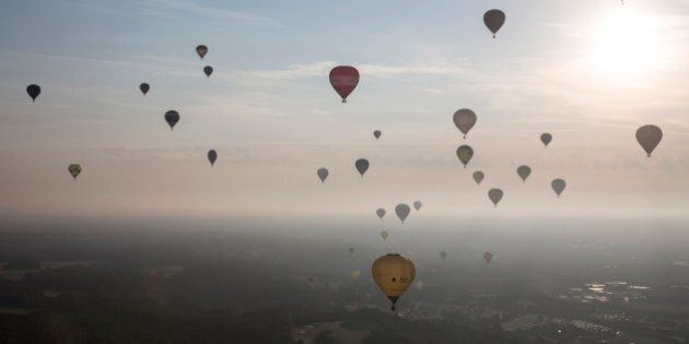 BRISTOL, ENGLAND - AUGUST 08:  Hot air balloons depart from Aston Court in a mass ascent on the first full day of the Bristol International Balloon Fiesta on August 8, 2014 in Bristol, England. Now in its 36th year, the Fiesta is Europe's largest annual hot air balloon event in the city that is seen by many as the home of modern ballooning.  (Photo by Oli Scarff/Getty Images)