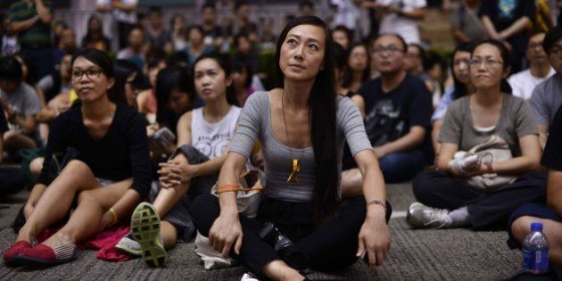 People attend a pro-democracy classroom next to a barricade in the Causeway Bay district of Hong Kong...