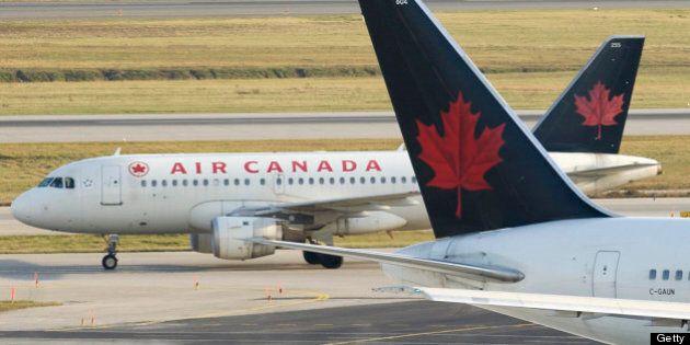 111103 File photo's of Air Canada jets, Jazz, Westjet, U.S Airways, ground personal unloading AC jet,...