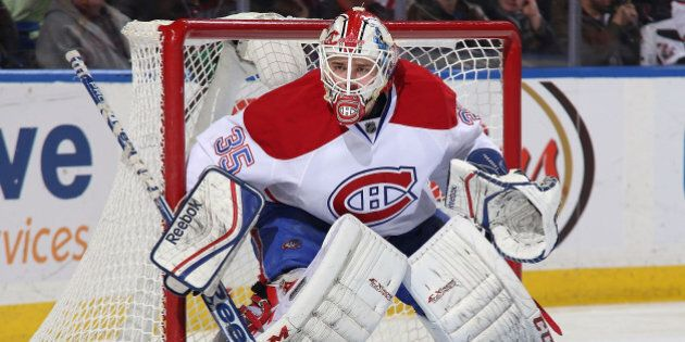 BUFFALO, NY - MARCH 16: Dustin Tokarski #35 of the Montreal Canadiens tends goal against the Buffalo...