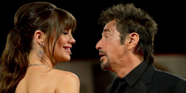 Al Pacino and Lucila Sola arrive for the screening of the movie 'Manglehorn' at the 71st edition of the Venice Film Festival in Venice, Italy, Saturday, Aug. 30, 2014. (AP Photo/Andrew Medichini)