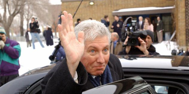 Montreal, CANADA: Gilles Duceppe, head of the Bloc Quebecois political party in Quebec, waves after voting...