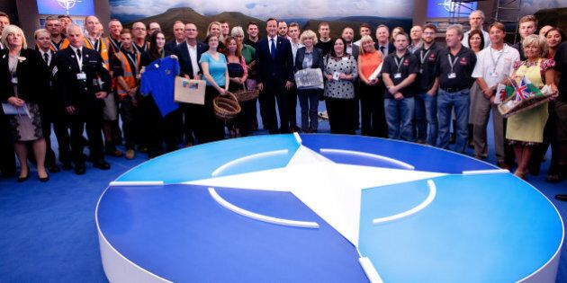 NEWPORT, WALES - SEPTEMBER 3: British Prime Minister David Cameron meets local producers who have helped...