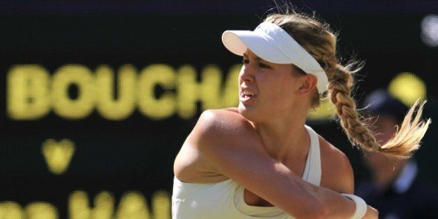 Canada's Eugenie Bouchard returns to Romania's Simona Halep during their women's singles semi-final match...