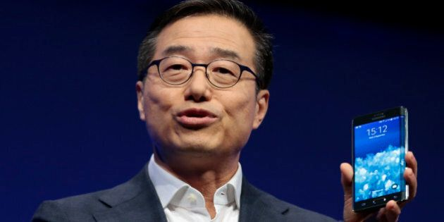 DJ Lee, Executive Vice President of Samsung, presents a Samsung Galaxy Note Edge during his keynote speech...