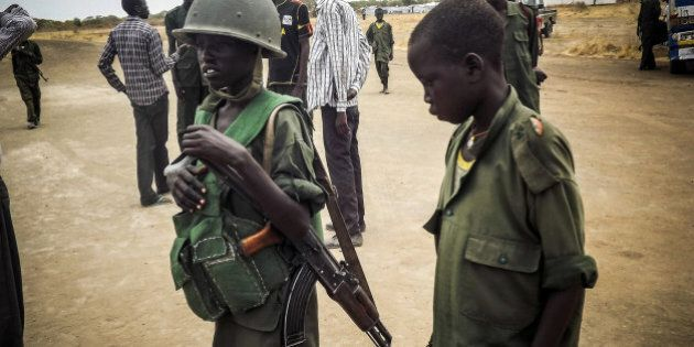 SOUTH SUDAN - MARCH 3: Child soldier is seen in military uniform in the South Sudan Democratic Movement/Army...