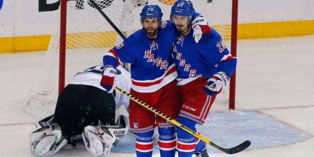 NEW YORK, NY - JUNE 11: Martin St. Louis #26 of the New York Rangers celebrates his goal on Jonathan...