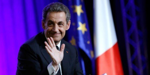 President of the UMP right-wing opposition party and former French President, Nicolas Sarkozy, gestures...