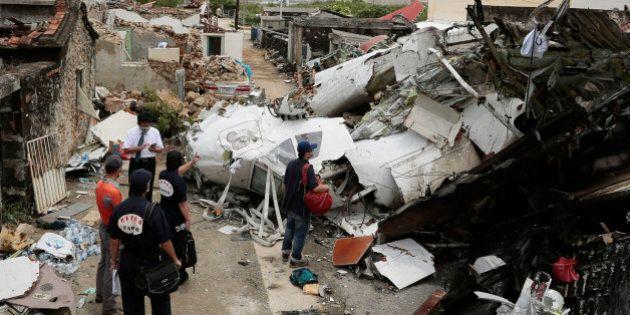 PENGHU ISLAND, TAIWAN - JULY 24: Criminal Investigation Bureau search through the crash site where TransAsia...