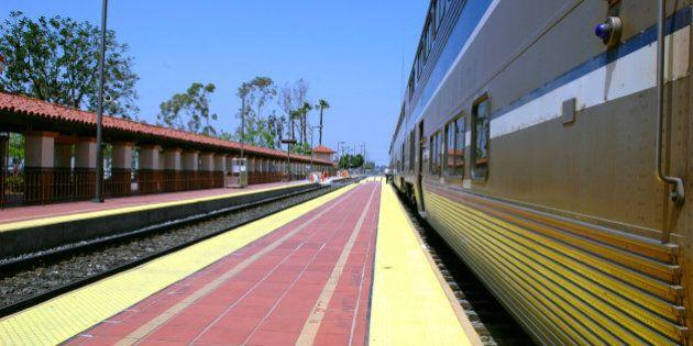 train stopped along a platform...