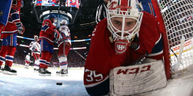 MONTREAL, QC - MAY 19: Dustin Tokarski #35 of the Montreal Canadiens falls to the ice after a play against...