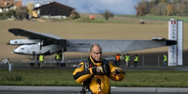 Swiss pilot Bertrand Piccard stands on November 13, 2014 in front of the solar-powered Solar Impulse...