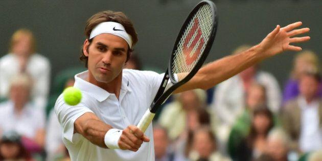 LONDON, ENGLAND - JUNE 26: Roger Federer of Switzerland returns the ball to Gilles Muller of Luxembourg...