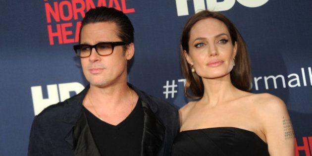 NEW YORK, NY - MAY 12:  Actors Brad Pitt and Angelina Jolie attends 'The Normal Heart' New York Screening at Ziegfeld Theater on May 12, 2014 in New York City.  (Photo by Bobby Bank/FilmMagic)