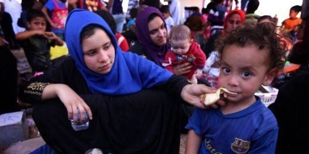 Irak: les jihadistes imposent leur autorité à Mossoul, exode de la population