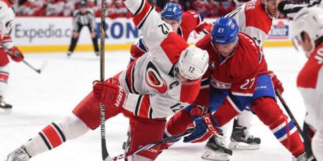 MONTREAL, QC - DECEMBER 16: Alex Galchenyuk #27 of the Montreal Canadiens faces off against Eric Staal...