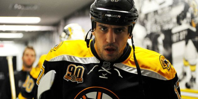 BOSTON, MA - APRIL 20: Milan Lucic #17 of the Boston Bruins walks down the hallway prior to warms ups...