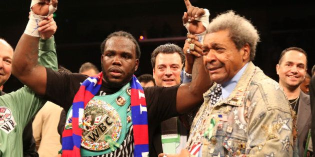 LOS ANGELES, CA - MAY 10:  Bermane Stiverne and promoter Don King pose for photos after Stiverne defeated Chris Arreola in their WBC Heavyweight Championship match at Galen Center on May 10, 2014 in Los Angeles, California.  Stiverne won in a six round technical knockout.  (Photo by Stephen Dunn/Getty Images)
