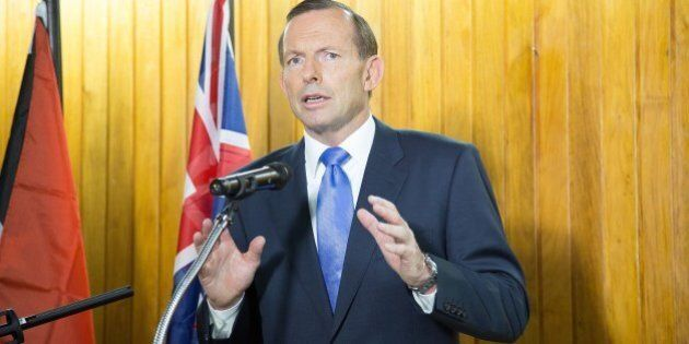 Australian Prime Minister Tony Abbott speaks at a joint press conference with Papua New Guinea's Prime...