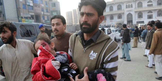 A Pakistani girl, who was injured in a Taliban attack in a school, is rushed to a hospital in Peshawar,...
