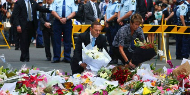 Australian Prime Minister Tony Abbott and his wife Margie pay their respect to the victims of the siege...