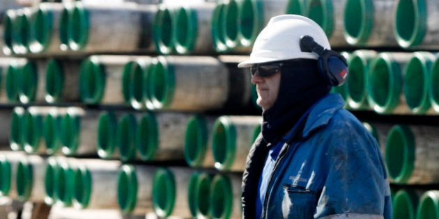 Worker with state-of-the art equipment of a shale gas rig of the Canadian-based Talisman Energy Inc....