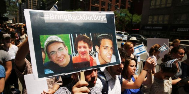 NEW YORK, NY - JUNE 16: People gather for a vigil for the three missing Israeli teens outside of the...