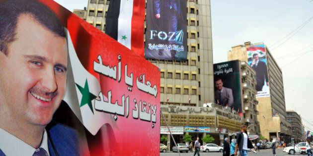 DAMASCUS, SYRIA - JUNE 2: Banners of Bashar al-Assad on the streets of Damascus within the presidential...