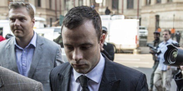 South African Paralympian Oscar Pistorius (C) arrives in Court in Pretoria on June 30, 2014. After a...