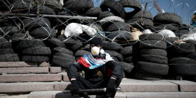 DONETSK, UKRAINE - APRIL 18: Awaiting of Pro-Russians keeps going on at the government building seized...
