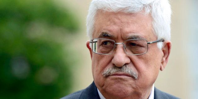 Palestine's authority president Mahmud Abbas listens to a speech by French President following their...