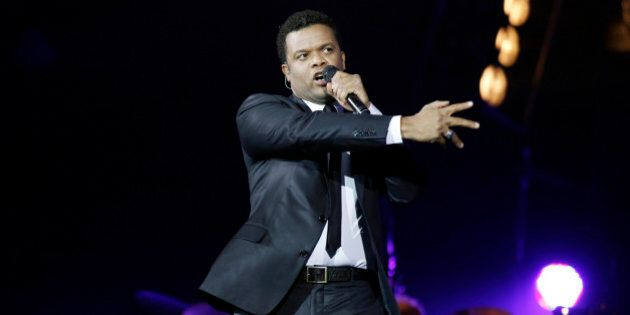 Haitian-born Canadian singer Luck Mervil performs on December 16, 2011 at Bercy (POPB) hall in Paris...