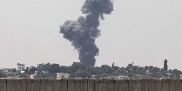 A picture taken from the southern Israeli Gaza border shows smoke billowing from the coastal Palestinian...