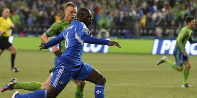 SEATTLE, WA - MARCH 02: Andy Rose #25, of the Seattle Sounders, chases Hassoun Camara #6, of Montreal...
