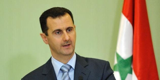 Syrian President Bachar el Assad gives a press conference with French President Nicolas Sarkozy (unseen)...