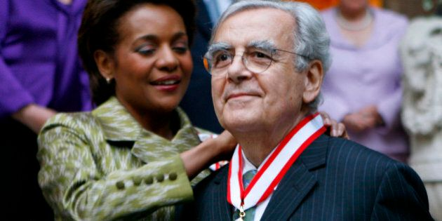 Canada's governor General Michaelle Jean, left, invests Bernard Pivot as a companion into the Order of...