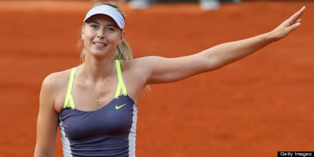 Russia's Maria Sharapova celebrates after winning her French tennis Open first round match on May 27,...